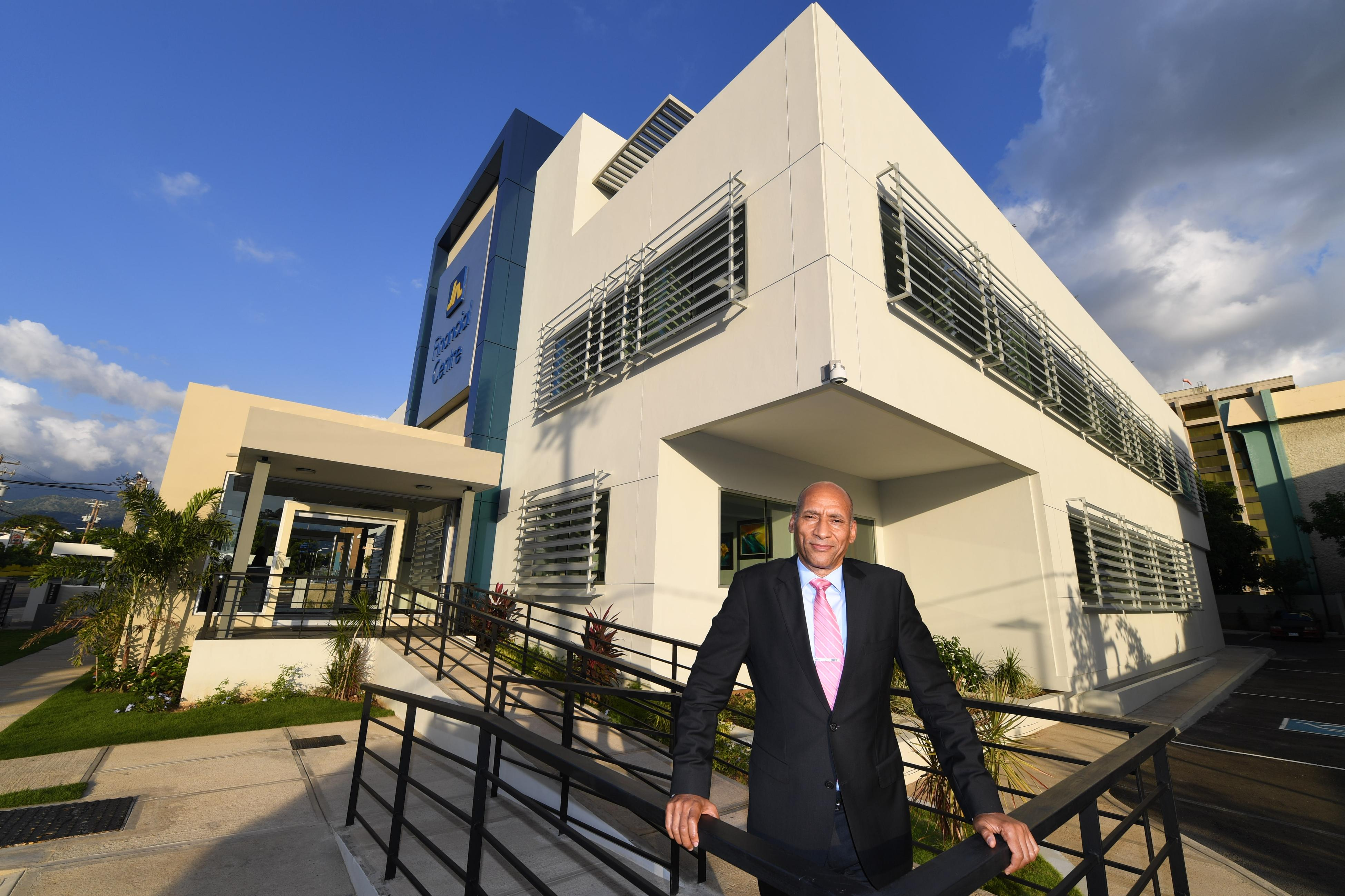 Alan Lewis, in front of the upgraded JN Financial Centre in New Kingston